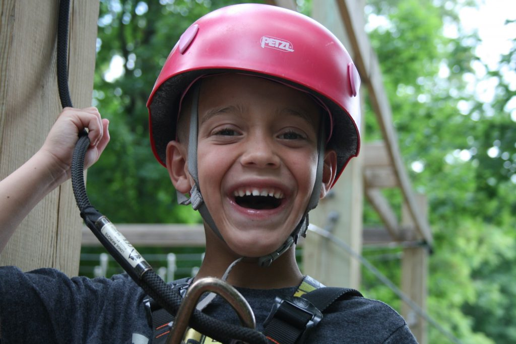 boy on harness at camp